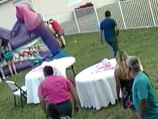 Man deflates bounce house with children inside, stirring outrage
