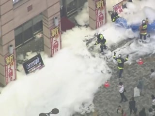 Avalanche of foam fills Tokyo street, caught on video