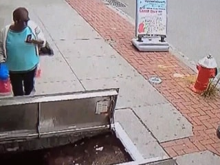 Woman on Phone Falls Through Open Sidewalk Doors