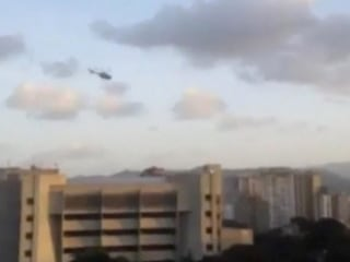 Helicopter Swoops Over Venezuela Supreme Court Amid Explosions, Gunfire