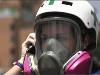Venezuela's 'Green Helmets' Risk Lives to Treat Wounded