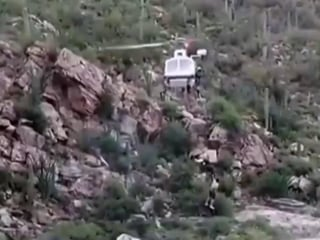 Watch: Helicopter rescues hikers trapped by flash flood in Arizona