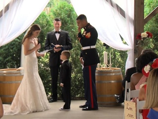 Watch Marine's son, 4, tearfully hug his new stepmom as she reads wedding vows