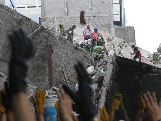 Desperate Search for Survivors Continues Amid Quake Rubble