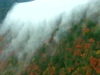 Rare Spectacular Cloud 'Waterfall' Cascades Over Mountain Peak