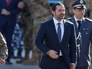 Lebanon prime minister seen at parade after mysterious resignation