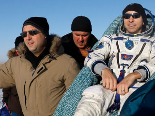 Space station astronauts touch down after months orbiting Earth