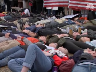 Students conduct a 'lie-in' to protest gun violence