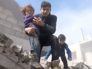 Kids rescued as shelling, airstrikes by Syrian forces kill at least 98 in one day