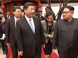 Kim says Beijing visit comes in a 'spring full of hope'