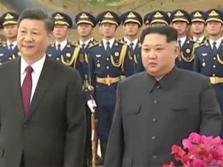 China reveals visit by North Korea's Kim Jong Un