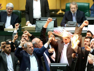 U.S. flag set ablaze in Iran's parliament after Trump pulls out of nuclear deal