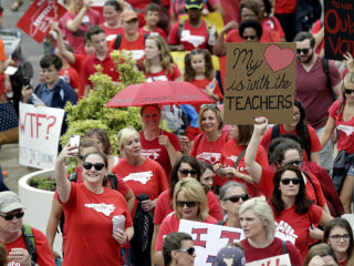 North Carolina teachers march for higher wages, school funding