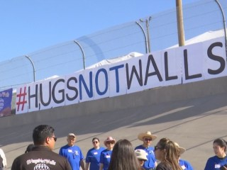 Families reunite at border for 'hugs not walls'