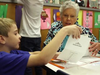 Kids learn cursive and connect with seniors through pen pal program