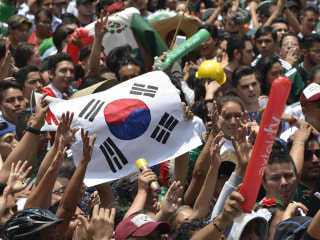Jubilant Mexico fans celebrate soccer success by thanking South Koreans