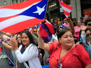 Thousands show Puerto Rican pride in first parade since Hurricane Maria