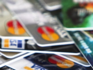 Major credit card companies are cutting their perks
