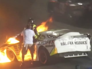 Father pulls son from burning car after racetrack crash