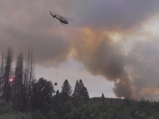 Firefighters scrambling to slow surging inferno near Yosemite