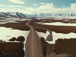 Ride along the scenic and vast Dalton Highway in Alaska