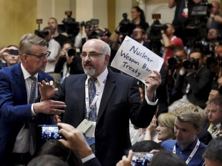 Journalist forcibly removed from Trump, Putin press conference room