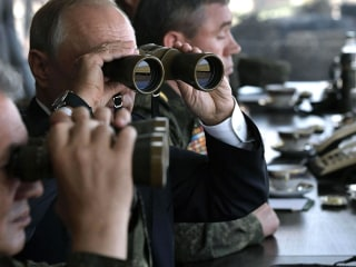 Putin watches huge Russian military drill, pledges to strengthen army
