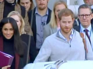 Beaming Meghan and Harry arrive in Australia as news of pregnancy breaks
