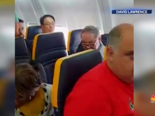 Video captures Ryanair passenger's racist rant at black woman