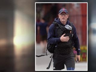 Daniel Craig shamed on social media for wearing a baby carrier
