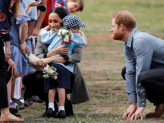 Meghan, Duchess of Sussex, hugs a young fan in Australia