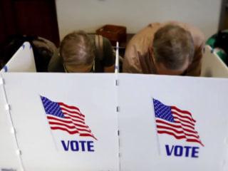 Democrats win House while Republicans keep Senate