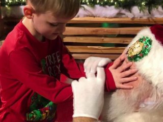 Santa helps a 6-year-old who is blind and has autism feel the spirit of Christmas