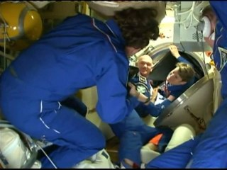 Astronauts dock safely at International Space Station
