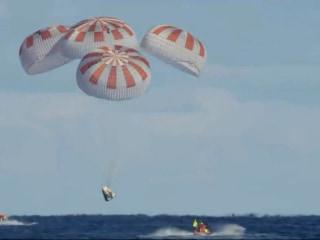 Watch SpaceX capsule splash down in return to Earth
