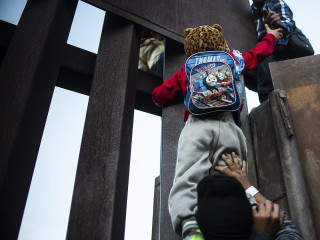 Behind the wall: How thousands of asylum seekers are trapped at the U.S. border