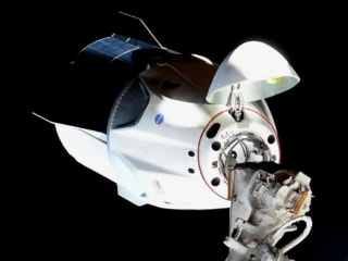 SpaceX Dragon successfully docks at space station in crucial test mission