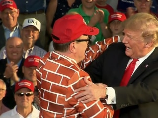 Trump brings man in a 'wall suit' on stage at rally