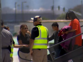Hundreds of migrants flown from Texas facilities to San Diego