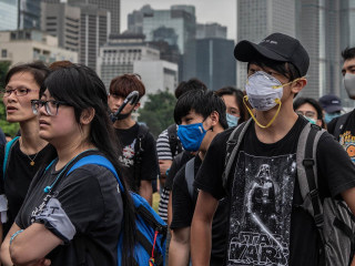 Hong Kong protesters allow roads to reopen as city's leader comes under increased pressure to step down