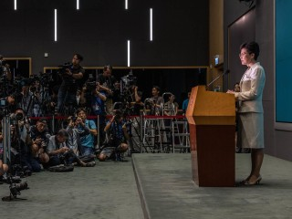 Embattled Hong Kong leader tells protesters: 'I've still got much to learn and do'
