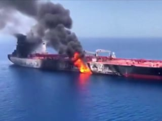 Attacked tanker arrives in port as U.S. accuses Iran of targeting drones