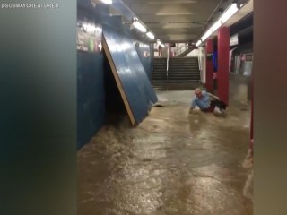 Scary video shows man nearly washed into approaching NYC train by floodwater