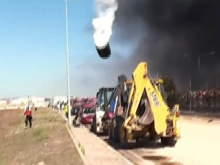 Explosion launches storage tank into the air as onlookers run for cover