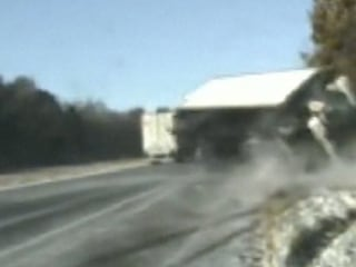 Watch truck on icy road narrowly miss 3 people changing a tire