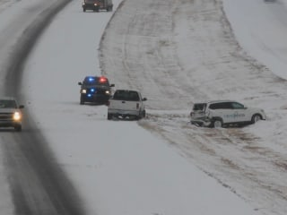 Giant winter storm barrels across Midwest, setting off dozens of crashes