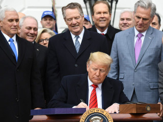Trump signs USMCA trade deal into law: 'This is a colossal victory'