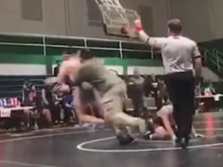 Video shows North Carolina dad tackling son's wrestling match opponent