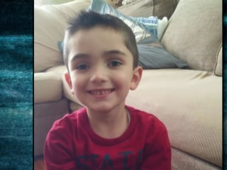 NYPD officer charged with murder of 8-year-old son who froze to death in garage