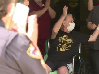 Coronavirus patient is released to cheers after two months in hospital